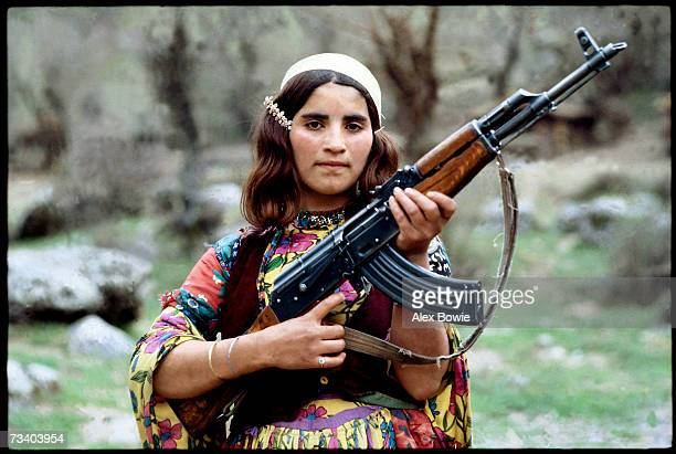 Fearful of an Iraqi military attack on the families mountain hideout in the Zagros Mountains of Northern Iraq a Peshmerga's daughter keeps an AK47...