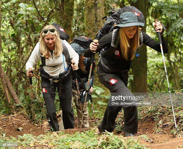 Fearne Cotton and Denise Van Outen trek through the rainforest on the first day of The BT Red Nose Climb of Kilimanjaro on March 1 2009 in Arusha...