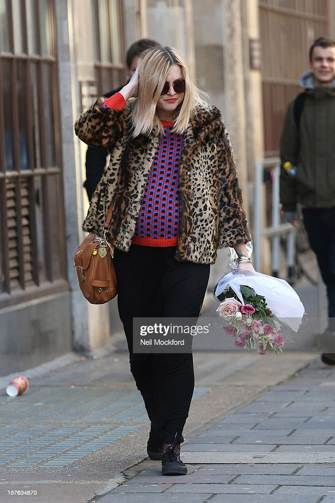Fearne Cotton is pictured carrying flowers on her last day at Radio 1 before her maternity leave starts on December 5, 2012 in London, England.
