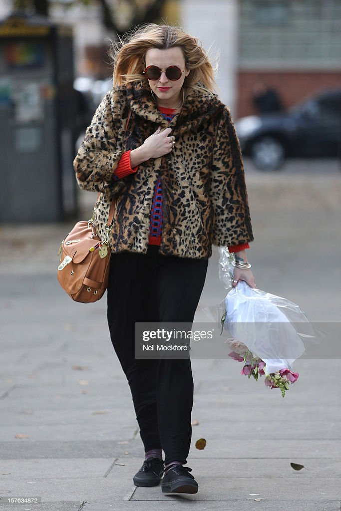 <a gi-track='captionPersonalityLinkClicked' href=/galleries/search?phrase=Fearne+Cotton&family=editorial&specificpeople=211497 ng-click='$event.stopPropagation()'>Fearne Cotton</a> is pictured carrying flowers on her last day at Radio 1 before her maternity leave starts on December 5, 2012 in London, England.