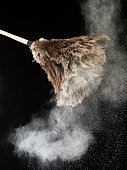 Feather duster with dust