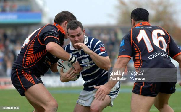 Featherstone Rovers' Gareth Handford is tackled by Oldham's Alex Wilkinson and Said Tamghart during the Cooperative National League Two Final at...