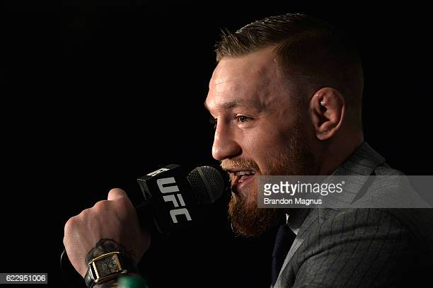 UFC featherweight and lightweight champion Conor McGregor of Ireland speaks to the media during the UFC 205 post fight press conference at Madison...