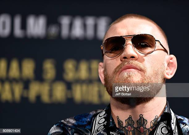 UFC featherweight champion and lightweight challenger Conor McGregor of Ireland answers questions from the media during the UFC 197 onsale press...