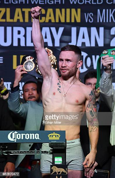 WBA featherweight champion Carl Frampton poses on the scale during his official weighin at MGM Grand Garden Arena on January 27 2017 in Las Vegas...