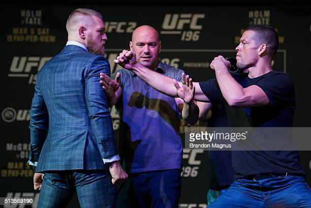 UFC featherweight champion Conor McGregor and Nate Diaz face off during the UFC 196 Press Conference at David Copperfield Theater in the MGM Grand...