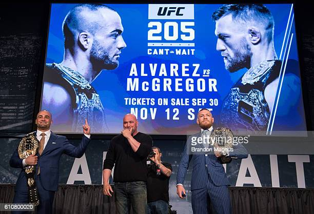 UFC featherweight champion Conor McGregor and UFC lightweight champion Eddie Alvarez pose for a picture during the UFC 205 press event at Madison...