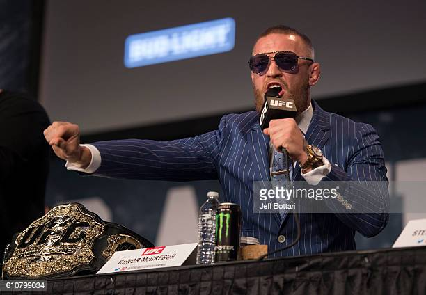UFC featherweight champion Conor McGregor of Ireland interacts with the media and fans during the UFC 205 press event at Madison Square Garden on...