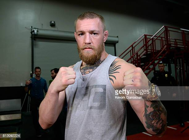 UFC featherweight champion Conor McGregor poses after a news conference with lightweight contender Nate Diaz at UFC Gym February 24 in Torrance...