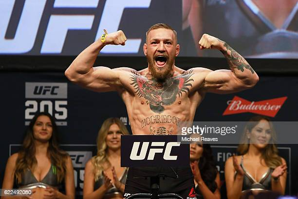 Featherweight Champion Conor McGregor reacts during UFC 205 Weighins at Madison Square Garden on November 11 2016 in New York City