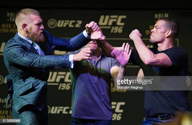 UFC featherweight champion Conor McGregor throws a punch towards Nate Diaz during the UFC 196 Press Conference at David Copperfield Theater in the...