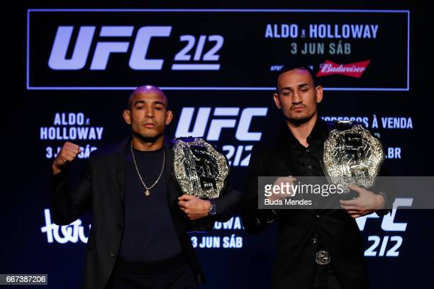 Featherweight Champion Jose Aldo of Brazil and challenger Max Holloway of the United States pose for photographers during the UFC 212 press...
