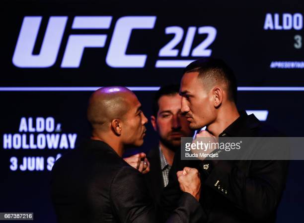 Featherweight Champion Jose Aldo of Brazil and challenger Max Holloway of the United States face off during the UFC 212 press conference at Morro da...