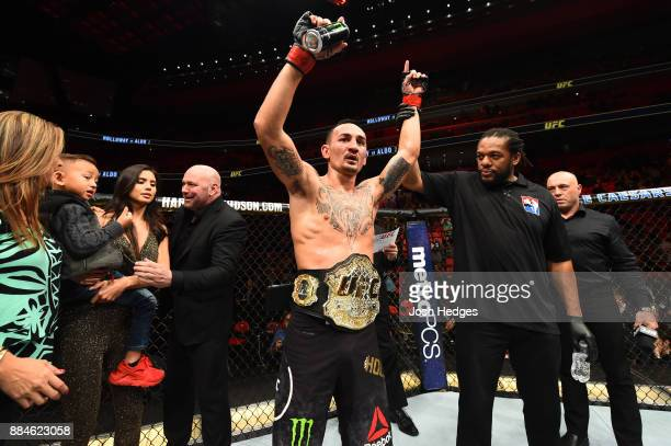 UFC featherweight champion Max Holloway celebrates after defeating Jose Aldo of Brazil in their UFC featherweight championship bout during the UFC...