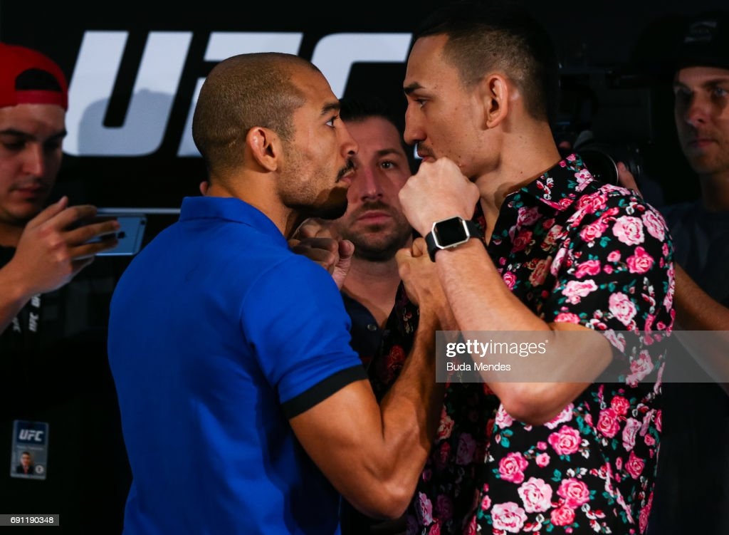 UFC featherweight fighters Jose Aldo (L) of Brazil and Max Holloway of the United States face off during Ultimate Media Day at Windsor Hotel on June 01, 2017 in Rio de Janeiro, Brazil.