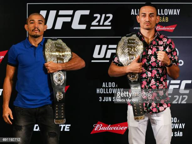 UFC featherweight fighters Jose Aldo of Brazil and Max Holloway of the United States pose for photographers during Ultimate Media Day at Windsor...