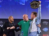 UFC featherweight title challenger Conor 'The Notorious' McGregor steals UFC Featherweight Champion Jose Aldo's belt as UFC President Dana White...
