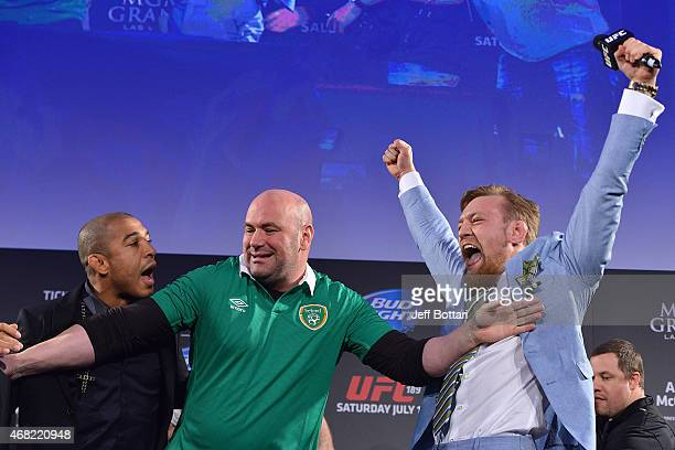 UFC featherweight title challenger Conor 'The Notorious' McGregor steals UFC Featherweight Champion Jose Aldo's belt as UFC President Dana White...