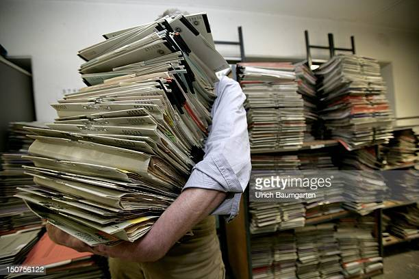 GERMANY Feature bureaucracy Our picture shows a man behind a mountain of files