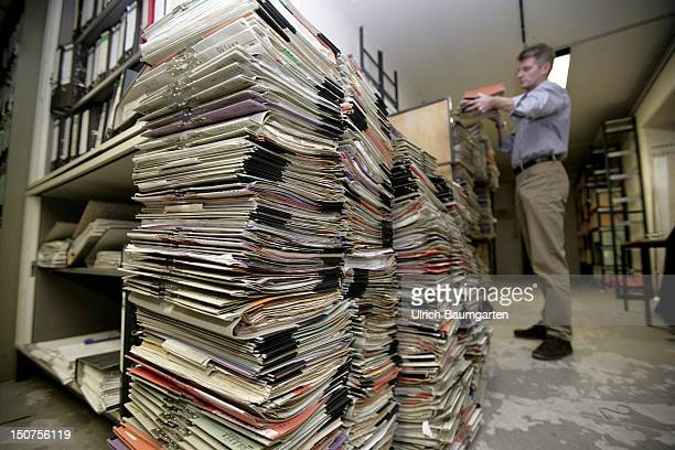 GERMANY Feature bureaucracy Our picture shows a man piling files in an archive