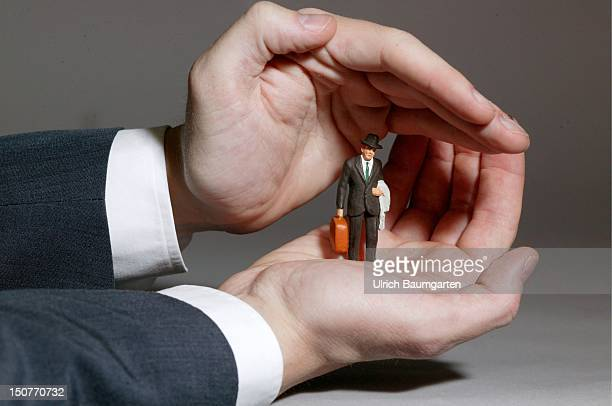Feature customer service the protected customer Hands protecting the figure of a man