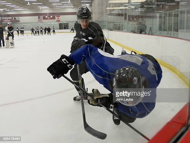 Feature on defenseman Duncan Siemens knocks Dennis Everberg to the ice during drills Siemens who was drafted No 11 by the Avalanche in 2011 workouts...