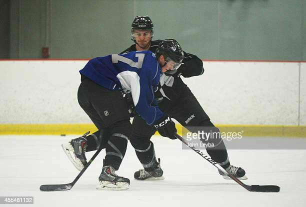 Feature on defenseman Duncan Siemens who was drafted No 11 by the Avalanche in 2011 workouts during rookie camp as he shoves Nick Magyar September 15...