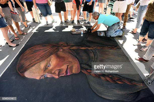 Featured chalk artist Stephen DeOrio right works on his reproduction piece entitled Brave by Andrew Wyeth during the 14th annual chalk art festival...