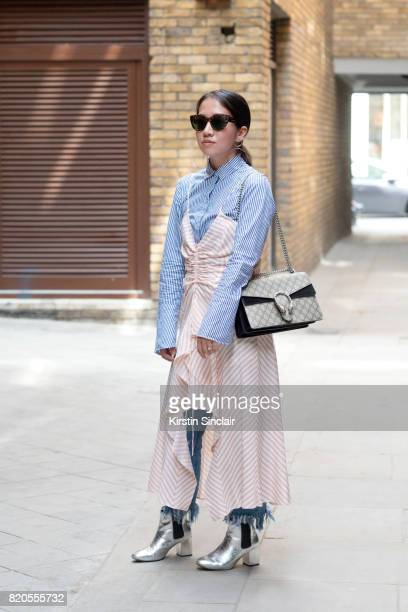 Features Editor for 26 Magazine Hannah Tan wears a Gucci bag Cheap Monday boots Preen dress Zara shirt Sunnies by Charlie sunglasses and Marques...