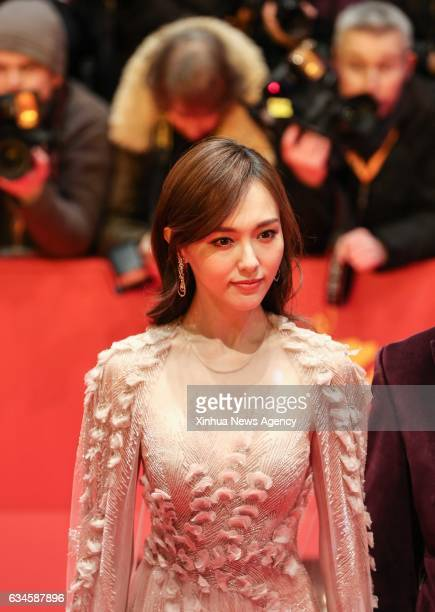 Chinese actress Tang Yan poses for photos on the red carpet of the opening ceremony of the 67th Berlinale International Film Festival in Berlin...