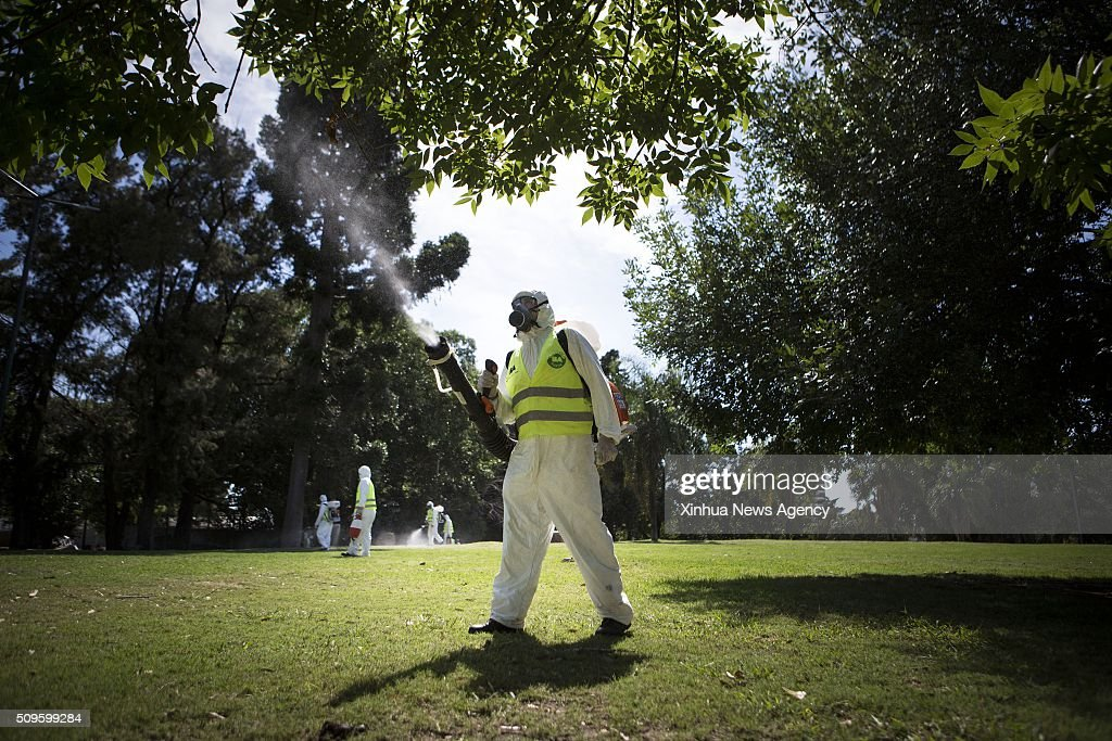 AIRES, Feb. 11, 2016 -- Argentina's Environment and Public Space Ministry fumigation brigade members spay insecticide in an area of Saavedra Park, in an effort to control the Aedes aegypti mosquito, in Buenos Aires, capital of Argentina, on Feb. 11, 2016.
