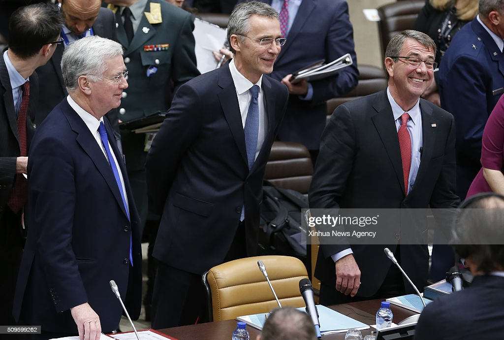 BRUSSELS, Feb. 11, 2016 -- British Defense Minister Michael Fallon, left, NATO Secretary General Jens Stoltenberg, center, and U.S. Secretary of State for Defense Ashton Carter attend a meeting of Coalition Efforts Against ISIL organized by the U.S. on the sideline of NATO Defense Ministers council at the alliance's headquarters in Brussels, Belgium, Feb. 11, 2016.