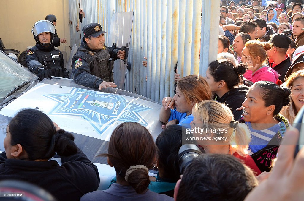 MONTERREY, Feb. 11, 2016 -- Family members of inmates wait for information outside the Topo Chico prison, in Monterrey, in the state of Nuevo Leon, Mexico, on Feb. 11, 2016. Jaime Rodriguez Calderon, governor of Nuevo Leon, informed a press conference that 52 people were killed and 12 injured after a fight broke out between two rival fractions of inmates inside the Topo Chico prison.
