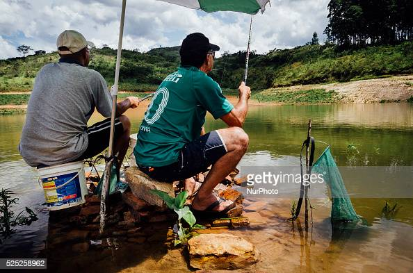 FILE Feb 14th 2015 Villagers fish near to water pumps in the Atibainha dam in Atibaia around 60 km northeast of S��o Paulo To get the water under the...