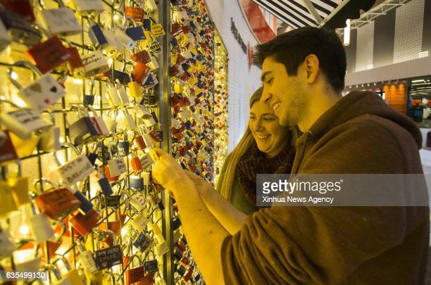 TORONTO Feb 15 2017 A couple hang their love lock on the wall during the Valentine's Day at a shopping centre in Toronto Canada Feb 14 2017