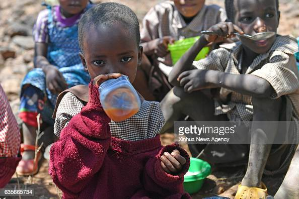A girl drinks water during lunch hour at Olomayiana West Primary School in Kajiado County Kenya Feb 15 2017 The Kenyan government last Friday...