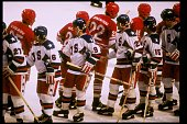 General view of teams from the United States and the Soviet Union shaking hands after the semifinal hockey game during the Winter Olympics in Lake...