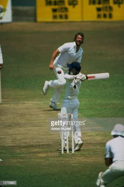 Ian Botham of England bowls a bouncer to Sidath Wettimuny of Sri Lanka during the Only Test match at P Saravanamuttu Stadium in Colombo Sri Lanka...
