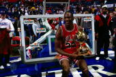 Michael Jordan of the Chicago Bulls celebrates after winning the 1987 NBA All Star Slam Dunk Competition at the Kingdome in Seattle WA HIGH...