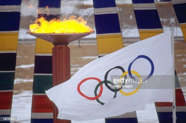 General view of the Olympic flag and flame at the 1988 Winter Olympic Games in Calgary Alberta Canada Mandatory Credit Allsport UK /Allsport