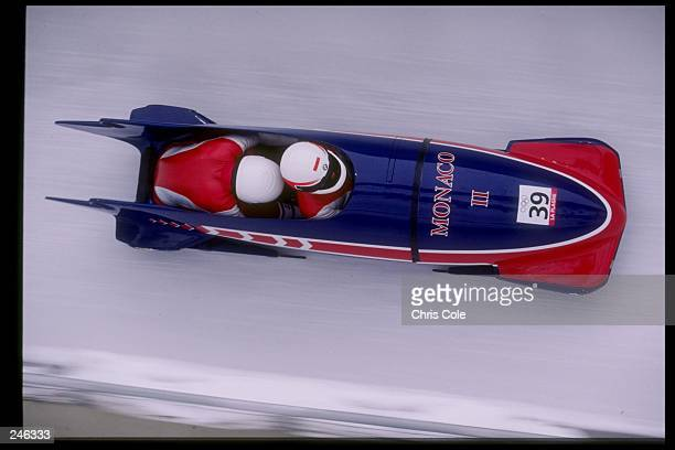 Albert Grimaldi and Pascal Camia of Monaco race down the track during the two man bobsleigh competition during the Olympic Games in Albertville...