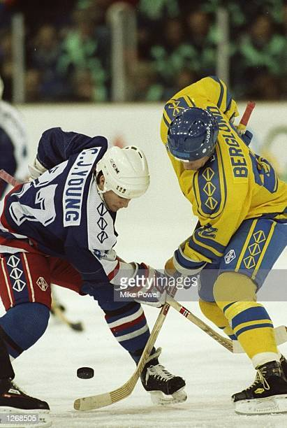 C J Young of the USA and Berglond of Sweden tackle for the puck during an Ice Hockey match at the 1992 Winter Olympics in Albertville France The...