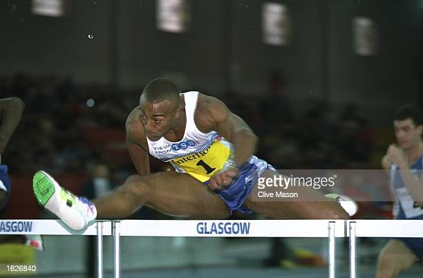 Colin Jackson of Great Britain in action during the 60 Metres hurdles event at the Interflora Challenge Great Britain v France in Glasgow Scotland...