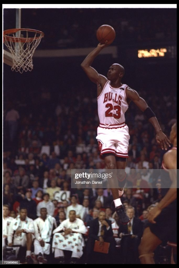 Guard Michael Jordan of the Chicago Bulls goes up for two during a first round playoff game against the against the Miami Heat at Miami Arena in...
