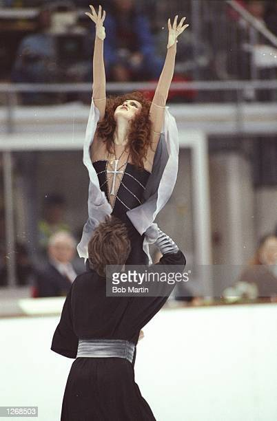 Sergei Ponomarenko lifts up Marina Klimova both of the Eastern Unified Natrions during the Ice Dancing event at the 1992 Winter Olympics in...