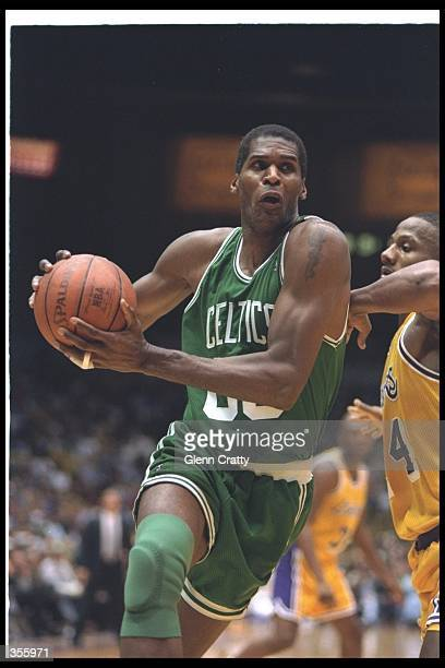 Center Robert Parish of the Boston Celtics moves the ball during a game against the Los Angeles Lakers at the Great Western Forum in Inglewood...