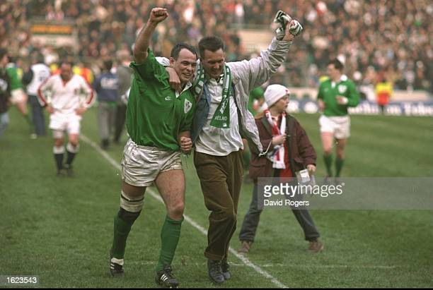Dennis McBride of Ireland celebrates with a fan after victory over England in the Five Nations Championship match at Twickenham in London England...