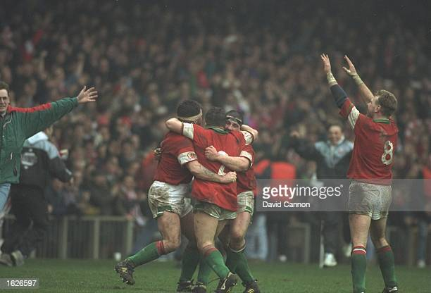 The Welsh team celebrate their victory after the 1994 Five Nations Championship match between Wales and France at the National Stadium in Cardiff...