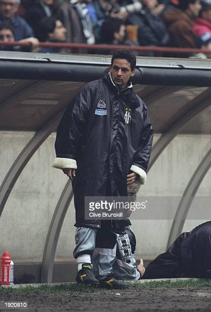Roberto Baggio of Juventus FC watches from the sidelines during a Serie A match against Inter Milan at the San Siro Stadium in Milan Italy The match...