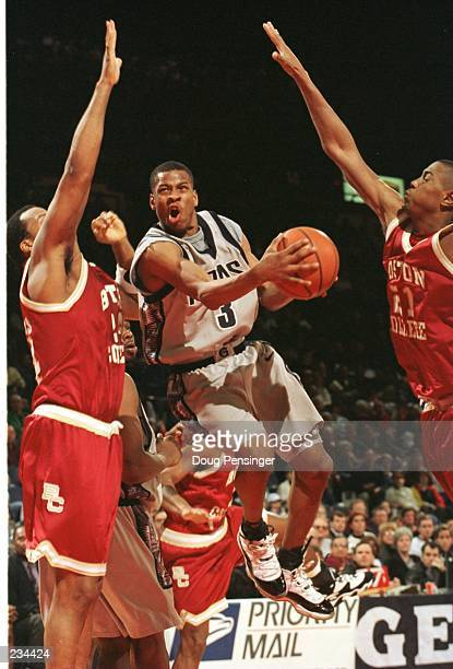 Allen Iverson of Georgetown University splits Danya Abrams and Antonio Granger of Boston College on the way to the basket during the Hoyas 6764 Big...